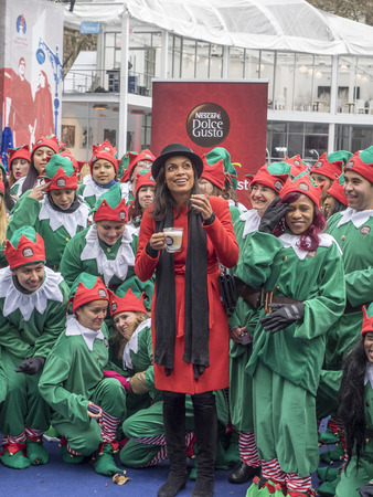 bryant: New York, NY, USA - December 2, 2014:  Actress Rosario Dawson kicks off Operation Give With Gusto in New York with NESCAFE Dolce Gusto and 100 Holiday Elves at Bryant Park, Manhattan Editorial