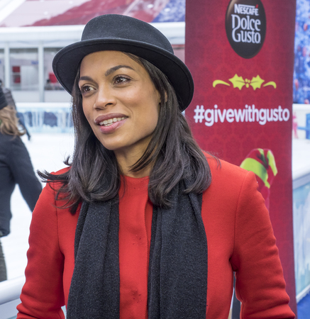 New York, NY, USA - December 2, 2014:  Actress Rosario Dawson kicks off Operation Give With Gusto in New York with NESCAFE Dolce Gusto and 100 Holiday Elves at Bryant Park, Manhattan Editorial