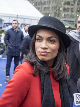 bryant park: New York, NY, USA - December 2, 2014:  Actress Rosario Dawson kicks off Operation Give With Gusto in New York with NESCAFE Dolce Gusto and 100 Holiday Elves at Bryant Park, Manhattan Editorial