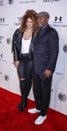 filmmaker: New York, NY, USA - April 19, 2015: Filmmaker Nelson George  and Recording artist Daisha attend the premiere of A Ballerinas Tale during the 2015 Tribeca Film Festival at BMCC Tribeca PAC, Manhattan Editorial