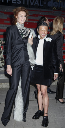 New York, NY, USA - April 14, 2015: Designer Zang Toi and Natasha Zupan attend the Vanity Fair Party during the 2015 Tribeca Film Festival at the New York State Supreme Court Building