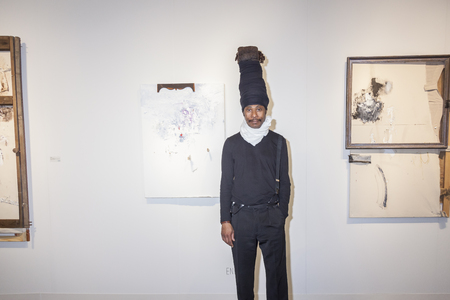 modern art: New York NY USA  May 14 2015: Artist Engels posing in front of his artwork at Art Miami New York the international contemporary and modern art fair at Pier 94 Manhattan
