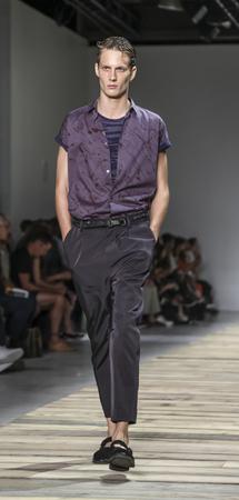 sq: New York, NY, USA - July 14, 2015: A model walks runway at the Robert Geller Runway show during New York Fashion Week: Mens SS 2016 at Skylight Clarkson Sq, Manhattan