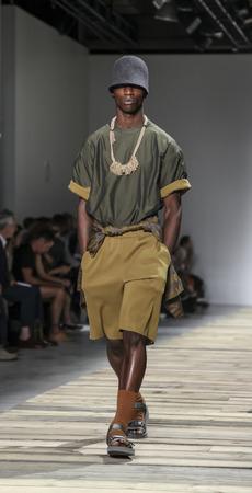 New York, NY, USA - July 14, 2015: A model walks runway at the Robert Geller Runway show during New York Fashion Week: Men's S/S 2016 at Skylight Clarkson Sq, Manhattan