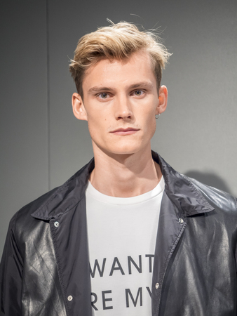 sq: New York, NY, USA - July 16, 2015: A model poses at the Roicardo Seco Luck collection presentation during New York Fashion Week: Mens SS 2016 at Skylight Clarkson Sq, Manhattan