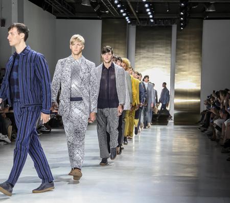 sq: New York, NY, USA - July 16, 2015: Models walk runway at the Perry Ellis Runway show during New York Fashion Week: Mens SS 2016 at Skylight Clarkson Sq, Manhattan Editorial
