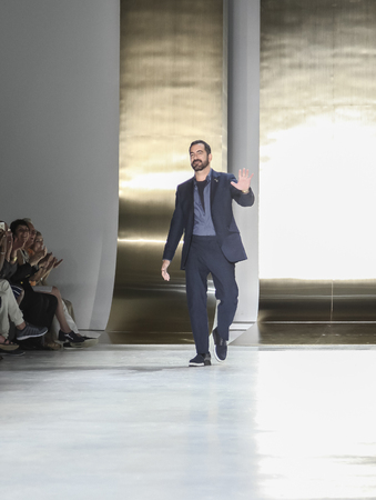 perry: New York, NY, USA - July 16, 2015: Fashion designer Perry Ellis cheers public on the runway at the Perry Ellis Runway show during New York Fashion Week: Mens SS 2016 at Skylight Clarkson Sq, Manhattan