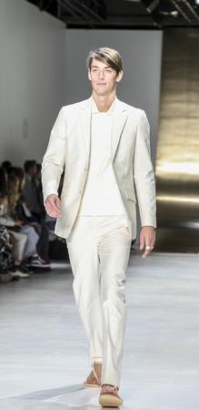sq: New York, NY, USA - July 16, 2015: A model walks runway at the Perry Ellis Runway show during New York Fashion Week: Mens SS 2016 at Skylight Clarkson Sq, Manhattan Editorial