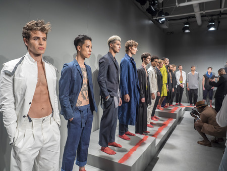 sq: New York, NY, USA - July 16, 2015: Model pose at the deTROIT mensweare collection presentation by John Varvatos during New York Fashion Week: Mens SS 2016 at Skylight Clarkson Sq, Manhattan