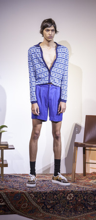 sq: New York, NY, USA - July 16, 2015: A model poses at the Orley collection presentation by Matthew, Alex, and Samantha Orley during New York Fashion Week: Mens SS 2016 at Skylight Clarkson Sq, Manhattan