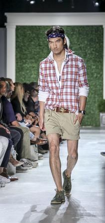 sq: New York, NY, USA - July 15, 2015: A model walks runway at the Michael Bastian Runway show during New York Fashion Week: Mens SS 2016 at Skylight Clarkson Sq, Manhattan