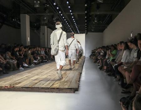 sq: New York, NY, USA - July 15, 2015: Models walk runway at the Greg Lauren Runway show during New York Fashion Week: Mens SS 2016 at Skylight Clarkson Sq, Manhattan Editorial