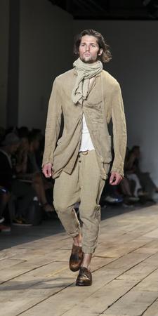 sq: New York, NY, USA - July 15, 2015: A model walks runway at the Greg Lauren Runway show during New York Fashion Week: Mens SS 2016 at Skylight Clarkson Sq, Manhattan