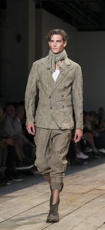 New York, NY, USA - July 15, 2015: A model walks runway at the Greg Lauren Runway show during New York Fashion Week: Men's S/S 2016 at Skylight Clarkson Sq, Manhattan 新闻类图片