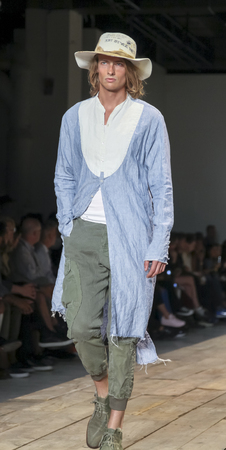 skylight: New York, NY, USA - July 15, 2015: A model walks runway at the Greg Lauren Runway show during New York Fashion Week: Mens SS 2016 at Skylight Clarkson Sq, Manhattan