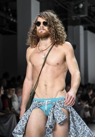 sq: New York, NY, USA - July 16, 2015: A model walks runway at the Parke & Ronen Runway show during New York Fashion Week: Mens SS 2016 at Skylight Clarkson Sq, Manhattan