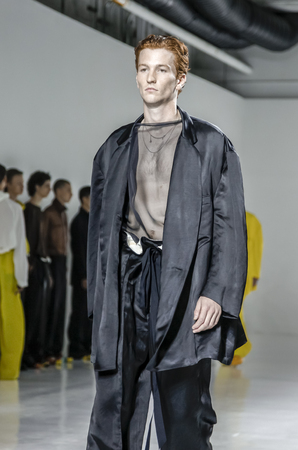 duckie: New York, NY, USA - July 14, 2015: A model walks runway at the Duckie Brown Runway show during New York Fashion Week: Mens SS 2016 at Skylight Clarkson Sq, Manhattan Editorial