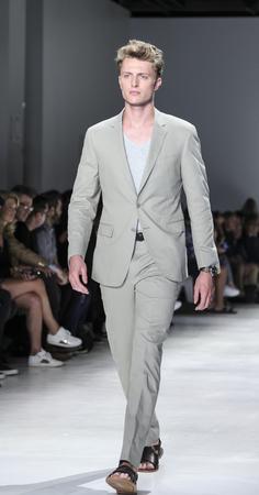 sq: New York, NY, USA - July 14, 2015: A model walks runway at the Todd Snyder Runway show during New York Fashion Week: Mens SS 2016 at Skylight Clarkson Sq, Manhattan Editorial