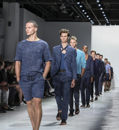 skylight: New York, NY, USA - July 14, 2015: Models walk runway at the Todd Snyder Runway show during New York Fashion Week: Mens SS 2016 at Skylight Clarkson Sq, Manhattan