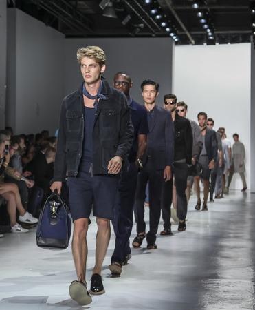 sq: New York, NY, USA - July 14, 2015: Models walk runway at the Todd Snyder Runway show during New York Fashion Week: Mens SS 2016 at Skylight Clarkson Sq, Manhattan
