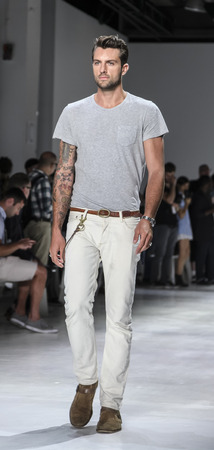 sq: New York, NY, USA - July 14, 2015: A model walks runway during rehearsal at the Todd Snyder Runway show during New York Fashion Week: Mens SS 2016 at Skylight Clarkson Sq, Manhattan