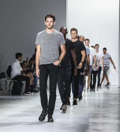 sq: New York, NY, USA - July 14, 2015: Models walk runway during rehearsal at the Todd Snyder Runway show during New York Fashion Week: Mens SS 2016 at Skylight Clarkson Sq, Manhattan