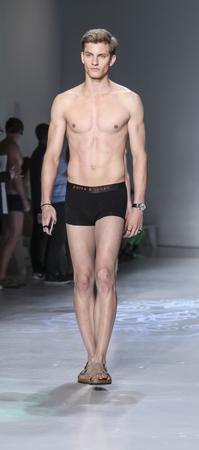 sq: New York, NY, USA - July 16, 2015: A model walks runway rehearsal at the Parke & Ronen Runway show during New York Fashion Week: Mens SS 2016 at Skylight Clarkson Sq, Manhattan Editorial