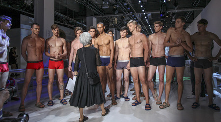 New York, NY, USA - July 16, 2015: Models are instructed before rehearsal at the Parke & Ronen Runway show during New York Fashion Week: Men's S/S 2016 at Skylight Clarkson Sq, Manhattan Editorial