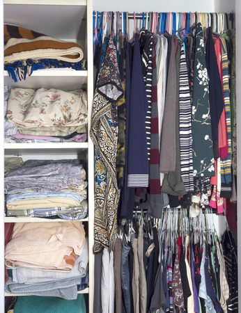 clothing rack: Open closet with shelves and coat hangers