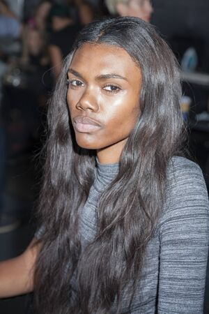 whit: New York, NY, USA - September 9, 2015: A model prepares backstage for the WHIT Spring 2016 collection presentation during New York Fashion Week SS 2016 at Puer 59, Manhattan. #WHIT2016, #CFDANYFW, #NYFW,