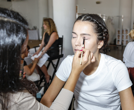 chapman: New York, NY, USA - October 8, 2015: A model prepares backstage for Marchesa FallWinter 2016 Bridal Presentation at Canoe Studio, Manhattan