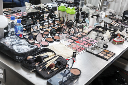 chapman: New York, NY, USA - October 8, 2015: Working space for make up artist on backstage for Marchesa FallWinter 2016 Bridal Presentation at Canoe Studio, Manhattan