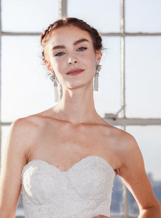 craig: New York, NY, USA - October 8, 2015: A model shows out a dress by Marchesa for Marchesa FallWinter 2016 Bridal Presentation at Canoe Studio, Manhattan