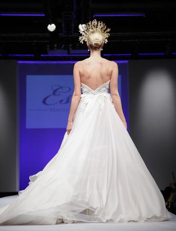 New York, NY, USA - October 11, 2015: A model walks runway for Israel Bridal couturier Ester 2016 Bridal Collection during New York International Bridal Week at the Fashion Theater, Pier 94, Manhattan Editöryel