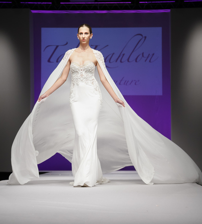 New York, NY, USA - October 11, 2015: A model walks runway for Israel Bridal couturier Tal Kahlon  2016 Bridal Collection during New York International Bridal Week at the Fashion Theater, Pier 94, Manhattan 新闻类图片