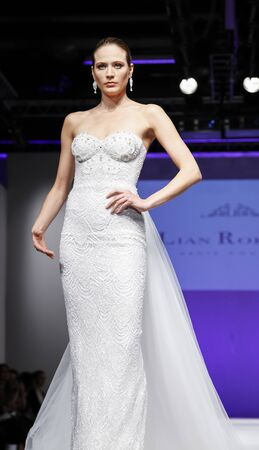 New York, NY, USA - October 11, 2015: A model walks runway for Israel Bridal couturier Lian Rokman 2016 Bridal Collection during New York International Bridal Week at the Fashion Theater, Pier 94, Manhattan