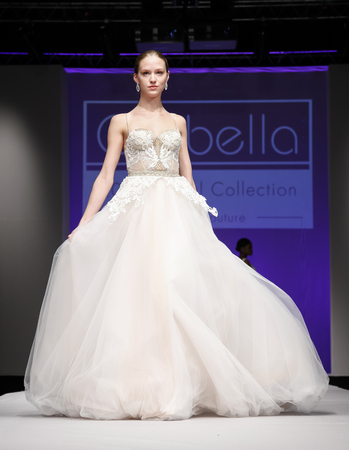 runway fashion: New York, NY, USA - October 11, 2015: A model walks runway for Israel Bridal couturier Orabella 2016 Bridal Collection during New York International Bridal Week at the Fashion Theater, Pier 94, Manhattan