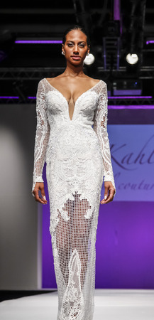 tal: New York, NY, USA - October 11, 2015: A model walks runway for Israel Bridal couturier Tal Kahlon  2016 Bridal Collection during New York International Bridal Week at the Fashion Theater, Pier 94, Manhattan Editorial