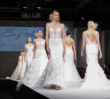 New York, NY, USA - October 10, 2015: Models walk runway for Eve of Milady & Amalia Carrara 2016 Bridal Collection during New York International Bridal Week at the Fashion Theater, Pier 94, Manhattan