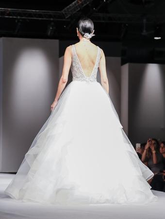 New York, NY, USA - October 10, 2015: A model walks runway for Eve of Milady & Amalia Carrara 2016 Bridal Collection during New York International Bridal Week at the Fashion Theater, Pier 94, Manhattan Editöryel