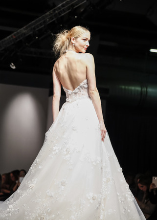 pretty dress: New York, NY, USA - October 10, 2015: A model walks runway for Eve of Milady & Amalia Carrara 2016 Bridal Collection during New York International Bridal Week at the Fashion Theater, Pier 94, Manhattan Editorial