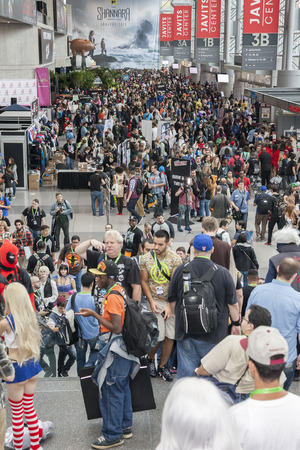 k 9: New York, NY, USA - October 9, 2015: General atmosphere on convention floor during Comic Con 2015 at The Jacob K. Javits Convention Center in New York City. The New York Comic Con is an annual New York City fan convention devoted to comics, graphic novels