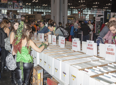 k 9: New York, NY, USA - October 9, 2015: Comic books vendor on convention floor during Comic Con 2015 at The Jacob K. Javits Convention Center in New York City. The New York Comic Con is an annual New York City fan convention dedicated to comics, graphic nove Editorial