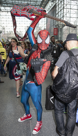 k 9: New York, NY, USA - October 9, 2015: Comic Con attendees pose in the costumes during Comic Con 2015 at The Jacob K. Javits Convention Center in New York City. The New York Comic Con is an annual New York City fan convention dedicated to comics, graphic no