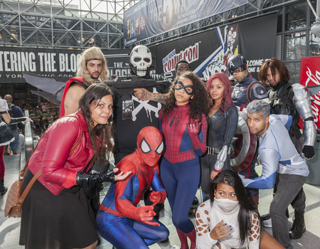New York, NY, USA - October 9, 2015: Comic Con attendees pose in the costumes during Comic Con 2015 at The Jacob K. Javits Convention Center in New York City. The New York Comic Con is an annual New York City fan convention dedicated to comics, graphic no