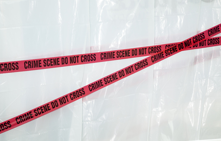 crime: Crime scene do not cross red tape on white background Stock Photo