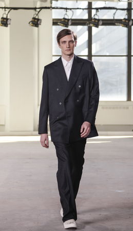 duckie: New York, NY, USA - February 2 2016:A model walks runway for Duckie Brown Fall 2016 runway show during NY Fashion Week Mens at Skylight Clarkson North, Manhattan