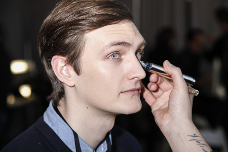 duckie: New York, NY, USA - February 2 2016:A model prepares backstage for Duckie Brown Fall 2016 runway show during NYFashion Week Mens at Skylight Clarkson North, Manhattan