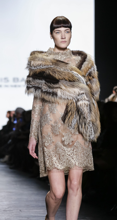 stage make up: New York, NY, USA - February 16, 2016: A model walks the runway at Dennis Basso runway show during of FallWinter 2016 New York Fashion Week at The Arc, Skylight at Moynihan Station, Manhattan.