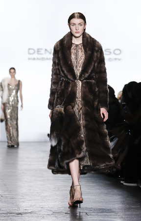 New York, NY, USA - February 16, 2016: A model walks the runway at Dennis Basso runway show during of Fall/Winter 2016 New York Fashion Week at The Arc, Skylight at Moynihan Station, Manhattan.